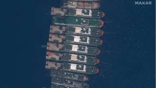 A handout satellite image made available by MAXAR Technologies shows Chinese vessels anchored at the Whitsun Reef in the disputed South China Sea on 23 March 2021 (issued 25 March 2021)
