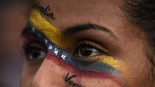 Venezuelans opposed to President Nicolas Maduro hold a demonstration in Medellin, Colombia in support of opposition leader Juan Guaido's self-proclamation as acting president of Venezuela, on January 23, 2019. (