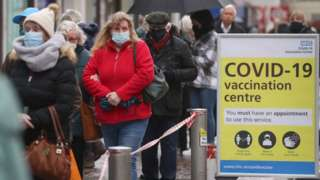 People queuing outside a vaccination centre in Folkestone, Kent