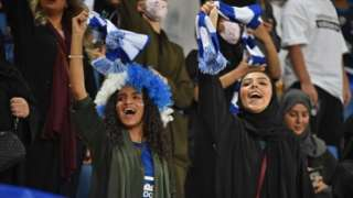 Women supporters of al-Hilal cheer for their team during the AFC Champions League quarter-finals football match between at King Saud University Stadium in Riyadh (17 September 2019)