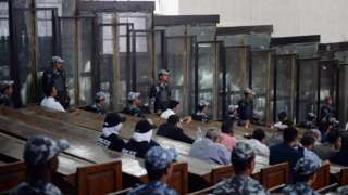 This picture shows the courtroom and soundproof glass dock (bottom) during the trial of Egyptian photojournalist Mahmoud Abu Zeid