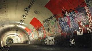 An abandoned metro station in Paris covered in graffiti