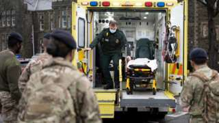 Soldiers at work on an ambulance