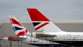 British Airways passenger planes are pictured at the apron at London Heathrow Airport