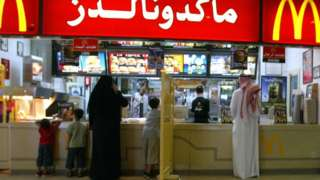 A segregation board separates women and families from men at a McDonalds restaurant in Riyadh. File photo