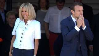 macron leaves polling station with wife Brigitte after voting