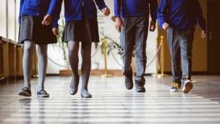 School children walking along a corridor
