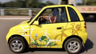 Members of the Indian Youth Climate Network drive A solar powered Reva electric car in New Delhi