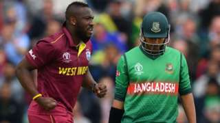 West Indies' Andre Russell and Bangladesh's Soumya Sarkar