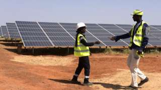 Technicians at a solar power facility in Sengal