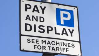 A pay and display parking sign