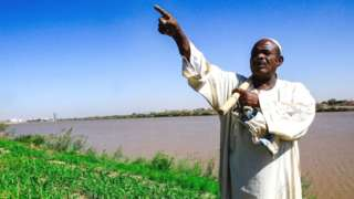 A farmer by the Nile in Sudan