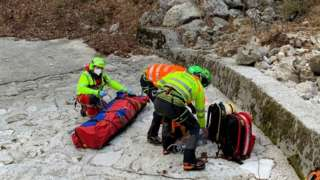 Rescuers with injured man