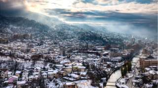 A city landscape of Sarajevo covered in snow