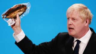Picture of Boris Johnson holding a kipper at the Conservative leadership hustings