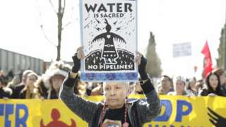 Harriet Prince, 76, of the Anishinaabe tribe marches with Coast Salish Water Protectors and others against the expansion of Trans Mountain pipeline on 10 March 2018
