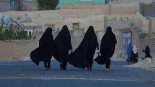 Women walking on a road