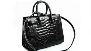 An alligator handbag.
