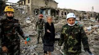 Rescuers and civilians amid debris in Ganja