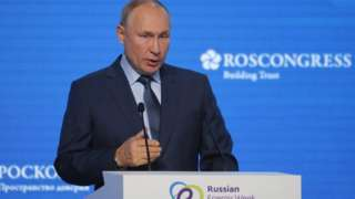 Russian President Vladimir Putin delivers a speech during a plenary session of the Russian Energy Week International Forum in Moscow, Russia October 13, 2021