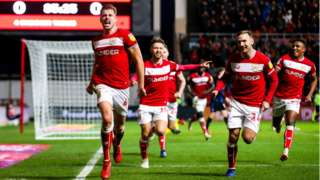 Adam Webster of Bristol City celebrates scoring a goal to make it 1-0