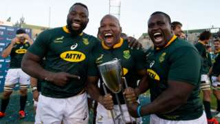 South Africa players Tendai Mtawarira (left), Bongi Mbonambi (centre) and Trevor Nyakane (right) celebrate after winning the 2019 Rugby Championship