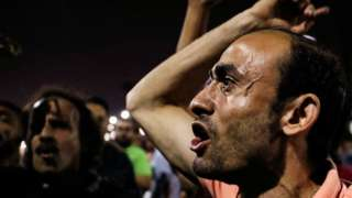 Small groups of protesters gather shouting anti-government slogans in central Cairo
