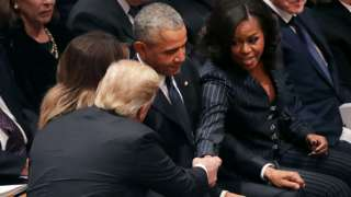 Trump and Michelle Obama shake hands