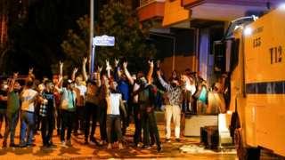 Demonstrators gesture during riots against refugees in Ankara, Turkey