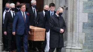 John Hume's coffin leaving St Eugene's Cathedral