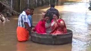 A couple travel to their wedding venue in a large cooking pot, Thalavady, Kerala state