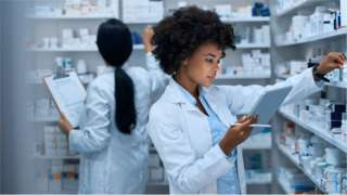 Pharmacists checking stock