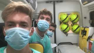 The three friends in an ambulance