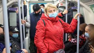 Woman wearing a mask on the Tube