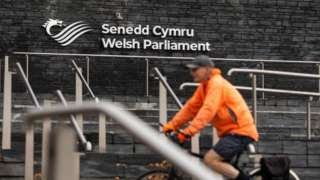 Cyclist in front of the Senedd