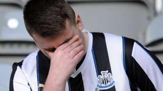 A Newcastle fan looks dejected