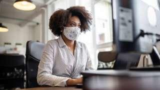 Office worker wearing mask