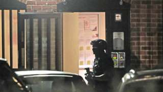 An armed police officer at a block of flats off Basingstoke Rd in Reading after an incident at Forbury Gardens in Reading town centre on 20 June 2020
