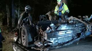 The remains of a Tesla vehicle are seen after it crashed in The Woodlands, Texas