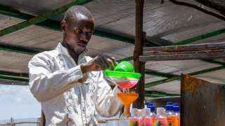 Innocent Havyariama is seen bottling some soap
