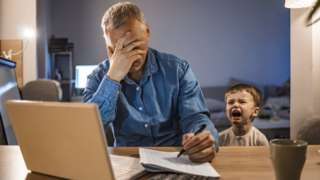 Man working from home with screaming child