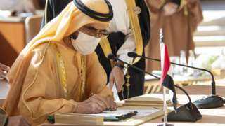 UAE Vice-President and Prime Minister Sheikh Mohammed bin Rashid Al Maktoum signs the al-Ula agreement at the GCC summit in Saudi Arabia (5 January 2020)