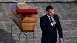 Emmanuel Macron in front of Samuel Paty's coffin