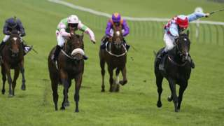 Neil Callan rides Amadeus Wolf (L) to win The Shadwell Stud Middle Park Stakes run at Newmarket Racecourse, on September 30, 2005 in Newmarket, England.