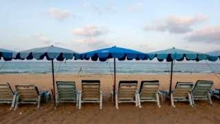 Empty chairs at a Thai beach