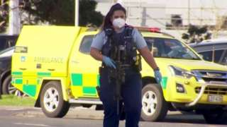 An armed police officer at the site of a knife attack in Auckland, New Zealand. Photo: 3 September 2021