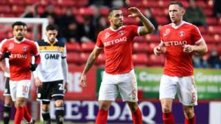 Josh Magennis (centre) celebrates his goal