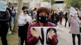 "A demonstrator attends a protest against the regional government""s measures to control the spread of the coronavirus disease (COVID-19), at Vallecas neighbourhood in Madrid, Spain, October 4, 2020."