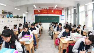 enior three students review their lessons carefully in the classroom, Guiyang City, Guizhou Province, China, May 20, 2021