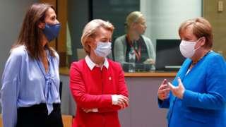 "Belgium's Prime Minister Sophie Wilmes and European Commission President Ursula von der Leyen speak with Germany""s Chancellor Angela Merkel"